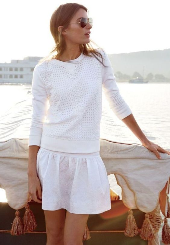 woman in white summer sweater and white skirt